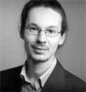 Dr. des. Konrad Sziedat